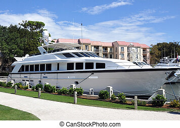 Luxury Yacht docked in a harbor