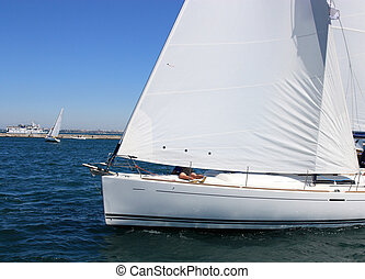 sailing boat at sea - 	white sailing boat at sea