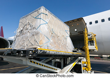 Loading freigth in airplane - Goods are loaded on the plane