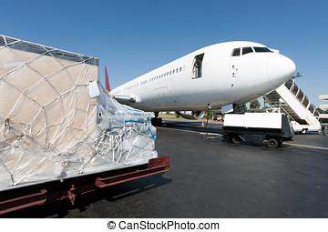 Loading freigth in airplane - Goods waiting loaded to the...