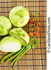 Kohlrabi, tomatoes and young peas - a Kohlrabi, tomatoes and...