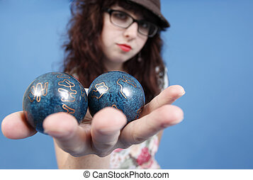 Blue balls - An attractive woman holding blue balls.