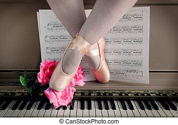 Ballet Legs in Pointe on Piano Keyboard - Ballerina Legs sit...