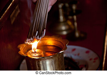 burning incense - a picture of a chinese temple