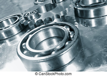 ball-bearings and gears, engineering concept in blue toning