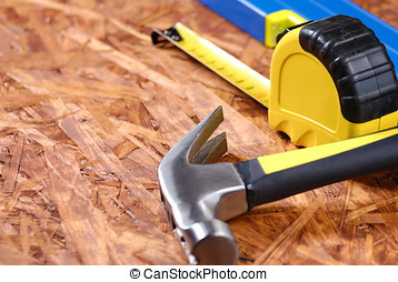Carpenter tools over hardboard