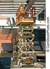 Painter on Hydraulic Scissor Lift - Construction worker on...