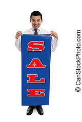 Man holding a SALE sign