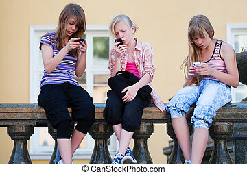 Teenage girls calling on the mobile phones
