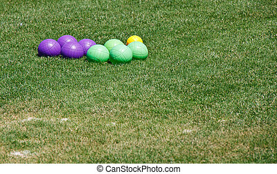 Purple and Green Bocce Balls in Grass - Green and Purple...