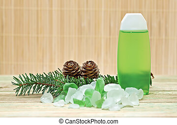 Coniferous extract bath with a sprig of pine needles, pine...