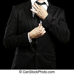 man adjusting his suit - young man adjusting his suit on a...