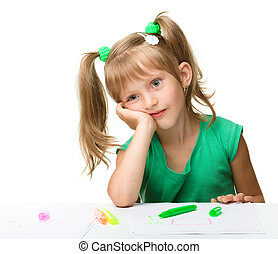 Cute little girl is tired with drawing
