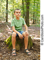 Boy outdoor in the forest - Portrait of a cute boy in the...