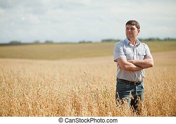 master on the field - owner to inspect the crop field