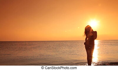 woman silhouette sunset