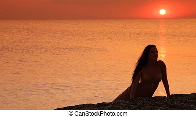 woman enjoying the golden sunset
