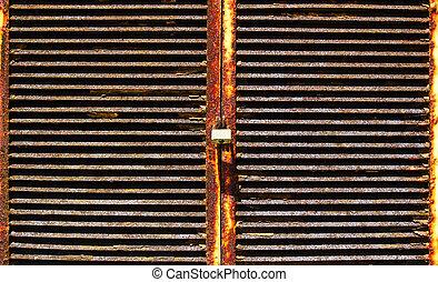 texture of a rusty metal door