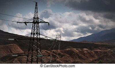 Electric transmission line on a background of clouds quickly...