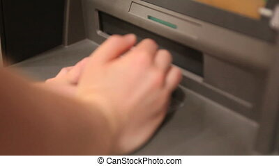 Person making a cash withdrawal at a cash disposer