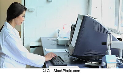 Charming woman working with a computer in a laboratory