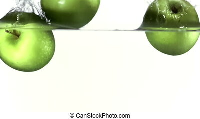 Apples falling into water slow motion filmed at 1000fps