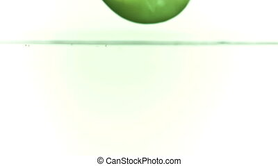Apple falling into water in slow motion filmed at 1000fps