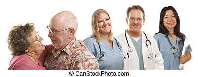 Senior Couple with Medical Doctors or Nurses Behind