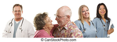 Senior Couple with Medical Doctors or Nurses Behind - Happy...