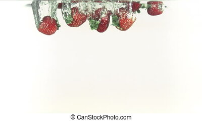 Strawberries splashing into water i - Strawberries splashing...