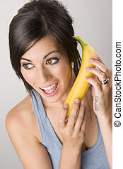 Beautiful Brunette holds a Banana