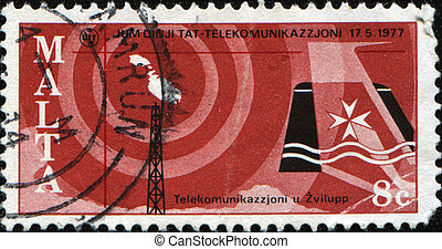 MALTA - CIRCA 1970: A stamp printed in Malta honoring World Telecommunications Day shows  Map, aerial and airplane tail-fin HORIZ , circa 1970