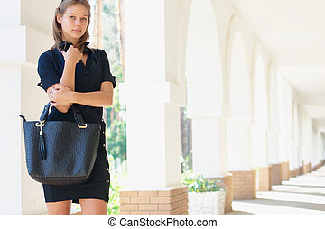 Young women with a handbag - Young women outdoors with a...