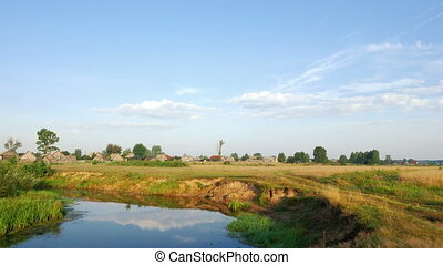Rural landscape - Time lapse clip of river and clouds over...