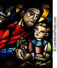 Stained glass window depicting Jesus and a child, in the...