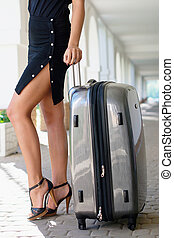 Sexy women with a luggage - Sexy women in a black dress with...