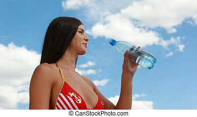 Thirst - Young beautiful girl drinking cool refreshing water...