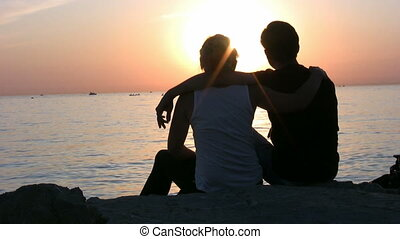 Couple sitting at the beach