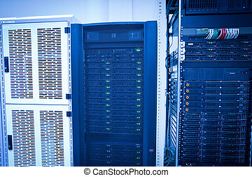 Server rack cluster in a data center shallow DOF; color...