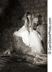portraite - attractive girl in the hay. runaway bride