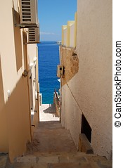 Narrow alley, Halki - A narrow alley leading down to Emborio...