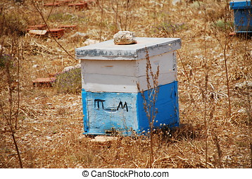 Wooden beehive, Halki - A wooden beehive, painted in the...