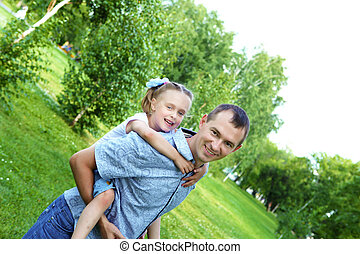 father and daughter in the summer park - Young father with...