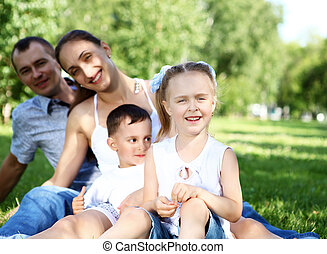 Family with two children in the summer park