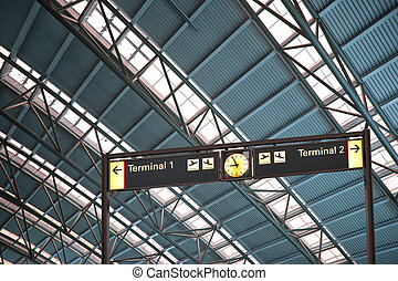 terminal 1 and 2 signs in airport interior