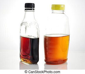 maple syrup and honey - bottles with maple syrup and honey...