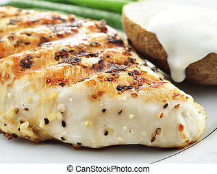 grilled chicken breast with vegetables, close up