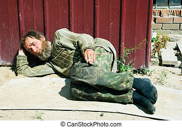 Homeless man sleeping - Painful morning of the alcoholic...