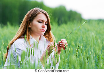 Young woman in a field - Young woman relaxing in a green...