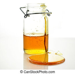 honey - fresh Honey pouring from jar